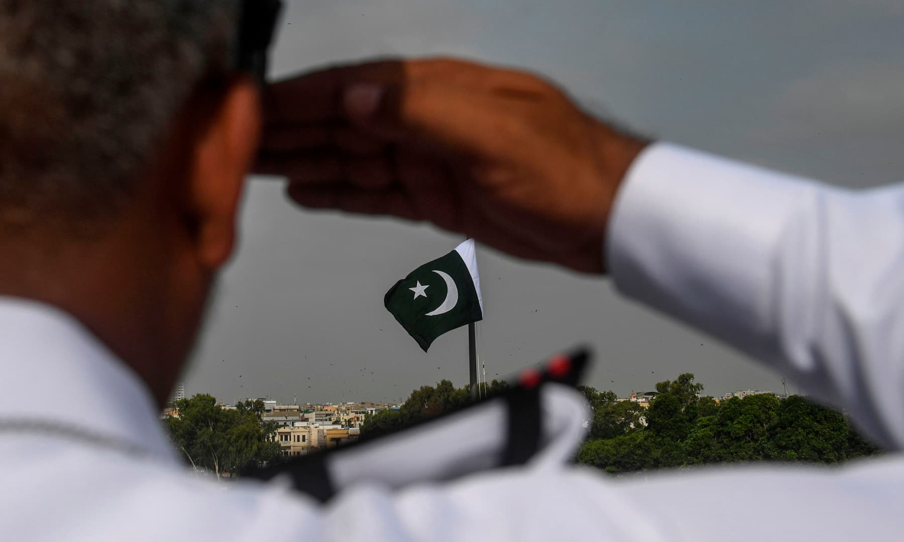 A Pakistan Navy officer salutes at the mausoleum of founder Muhammad Ali Jinnah during the Independence Day celebrations in Karachi on August 14. — AFP
