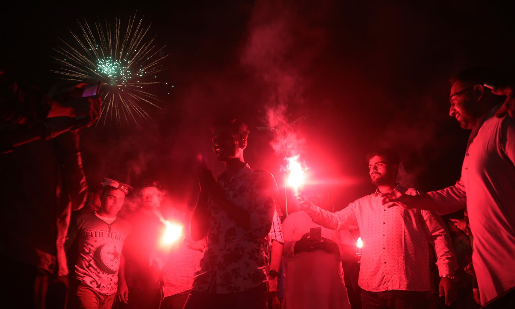 People light up fireworks during Independence Day celebrations in Karachi, Friday, Aug 14. — AP