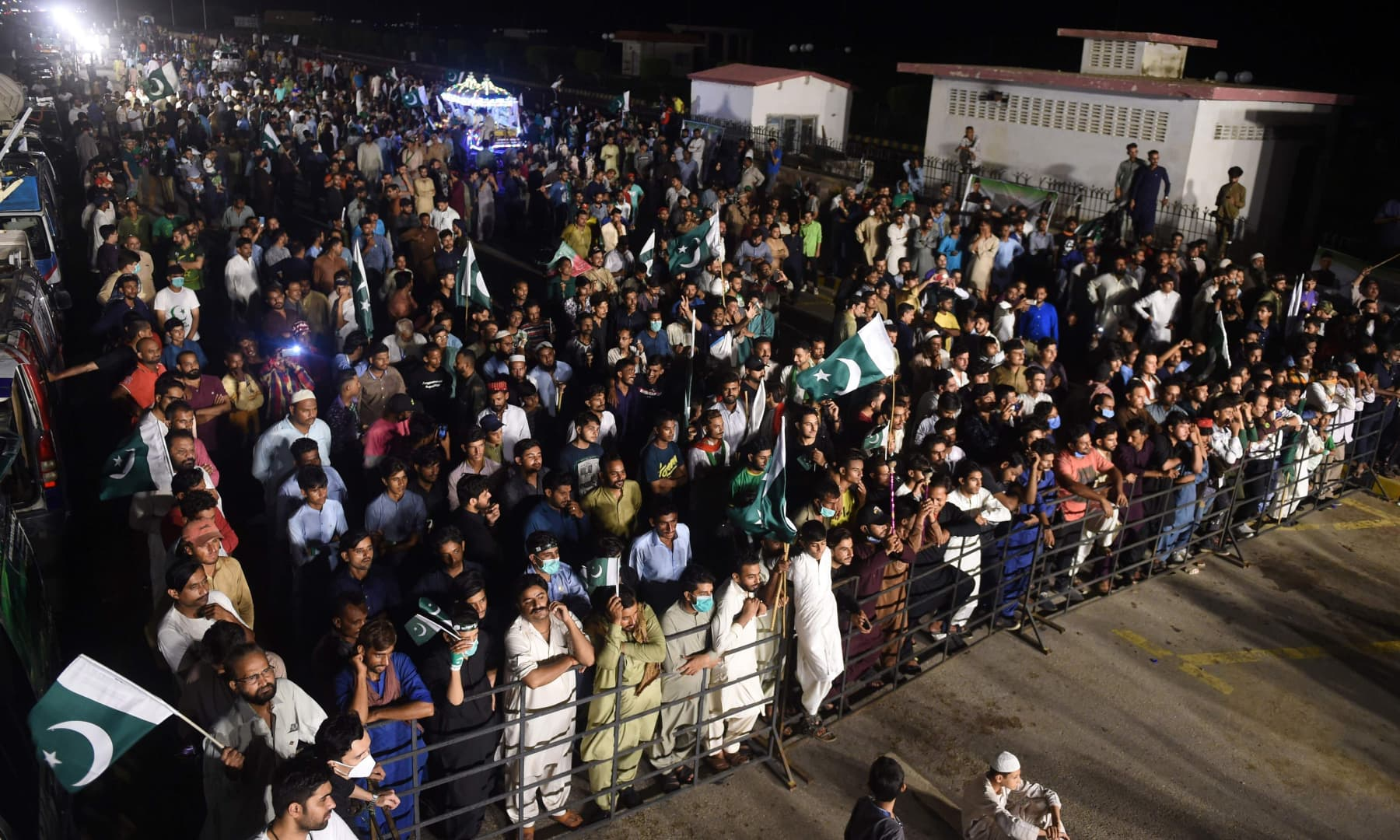 People gather during Independence Day celebrations in Karachi on August 14. — AFP