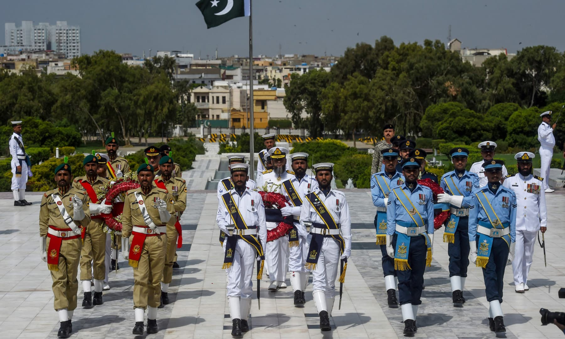 Soldiers march to lay wreaths on the mausoleum of founder Muhammad Ali Jinnah during Independence Day celebrations in Karachi on August 14. — AFP