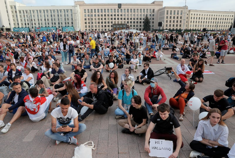 People attend an opposition demonstration to protest against police violence and to reject the presidential election results near the Government House in Independence Square in Minsk, Belarus August 14, 2020. — Reuters