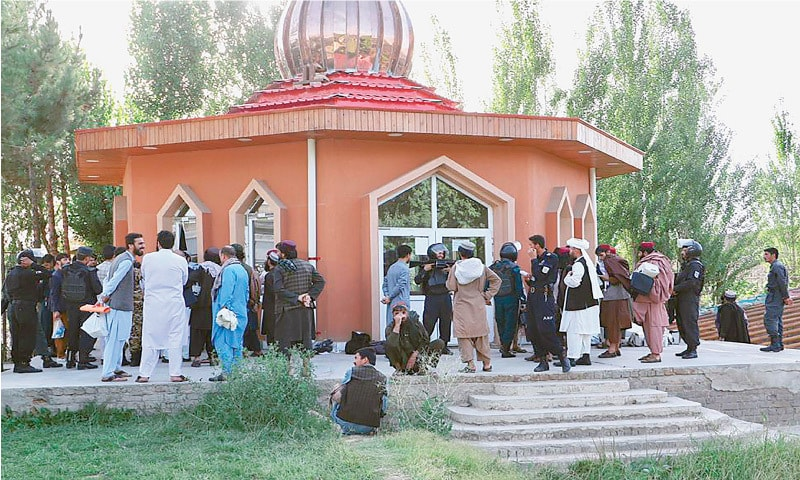 KABUL: This photo released by Afghanistan's National Security Council shows Taliban prisoners gathering as their cases are processed at the Pul-i-Charkhi prison before their release.—AFP