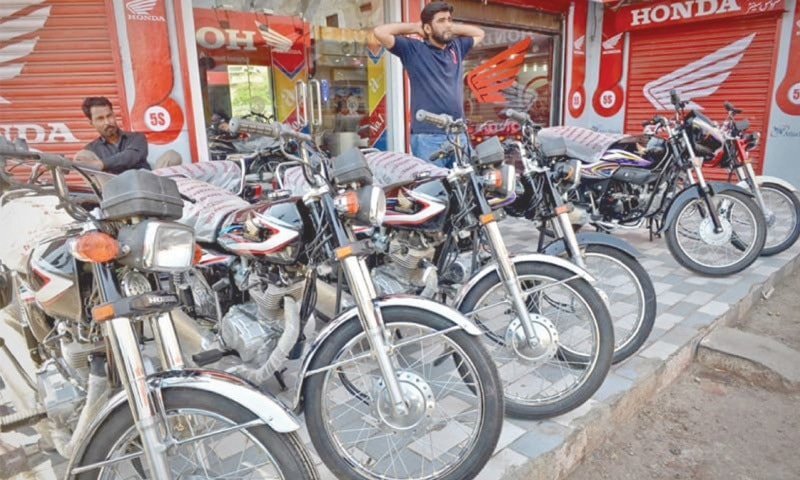 Lockdown to prevent the spread of Covid-19 pandemic hit manufacturing sector, including the production of two-wheelers.—Dawn file photo