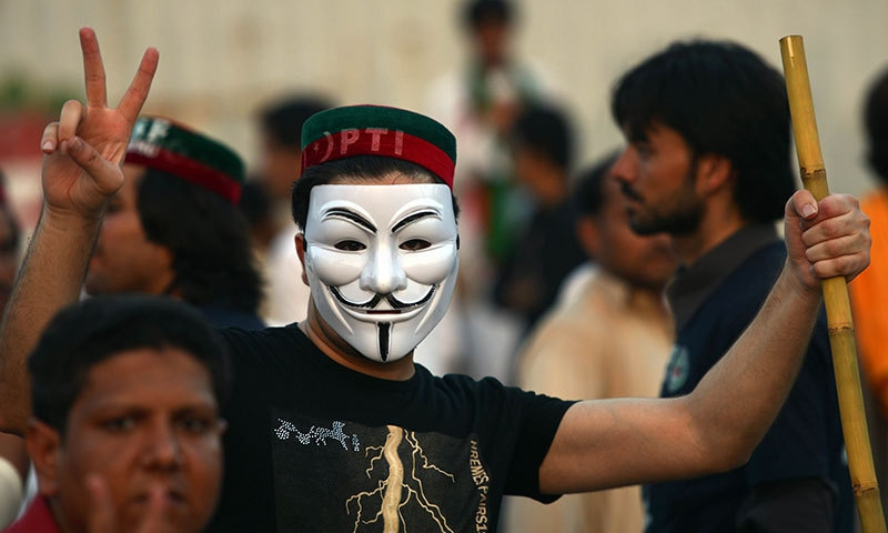 A supporter of Imran Khan flashes a victory sign during a protest march against the PML-N government in 2014 | AFP