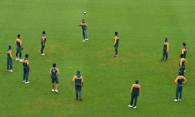 Pakistan players warm up with a football on the field as the start of play is delayed on the third day of the second Test between England and Pakistan at the Ageas Bowl in Southampton, southwest England on August 15. — AFP