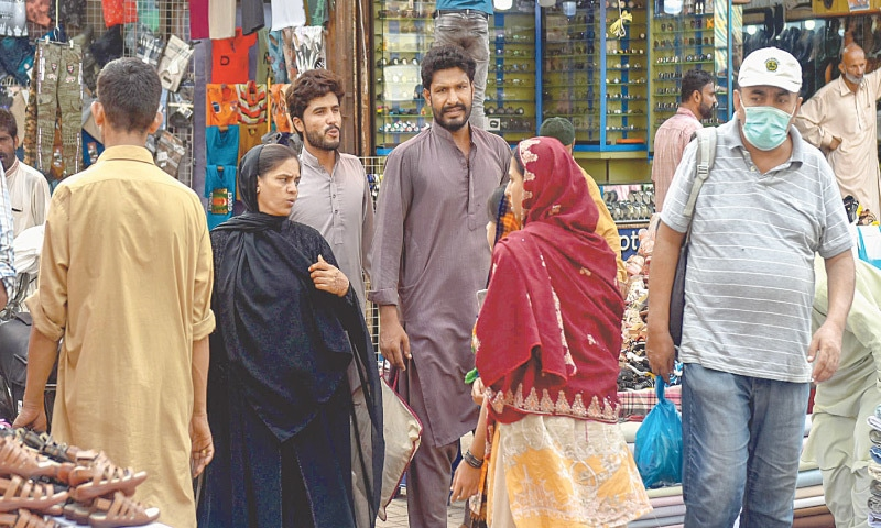 MEN, women and even shopkeepers have almost stopped wearing face masks in crowded markets in the city as seen here. — Fahim Siddiqi / White Star