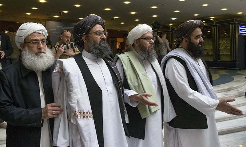 In this May 2019 file photo, Mullah Abdul Ghani Baradar, the Taliban group's top political leader, second left, arrives with other members of the Taliban delegation for talks in Moscow, Russia. — AP