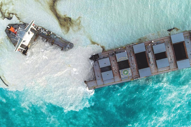 THIS aerial picture taken on Sunday shows the oil tanker MV Wakashio after it broke into two parts near Blue Bay Marine Park, Mauritius. The ship had run aground recently and leaked more than 1,000 tonnes of oil in pristine waters off the Mauritius coast.—AFP