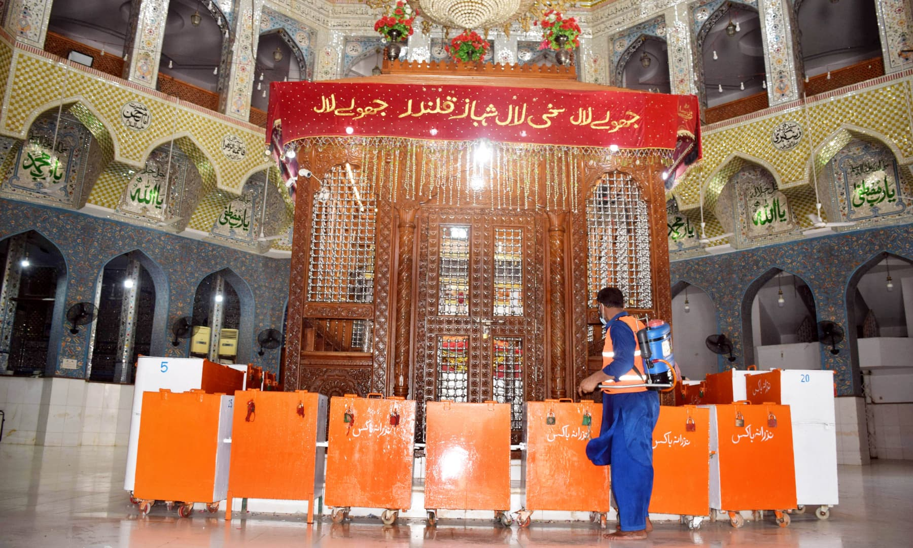 A town committee worker sanitises the inner sanctum of the shrine on Monday after it was reopened for visitors.