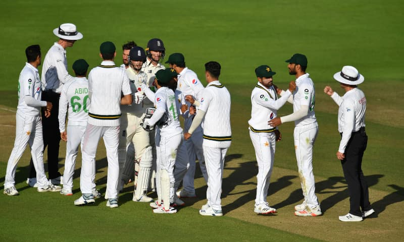 Umpires and players of both teams greet each other at the end of the fifth day of the second Test between England and Pakistan, at the Ageas Bowl in Southampton, England, Monday, Aug 17. — AP