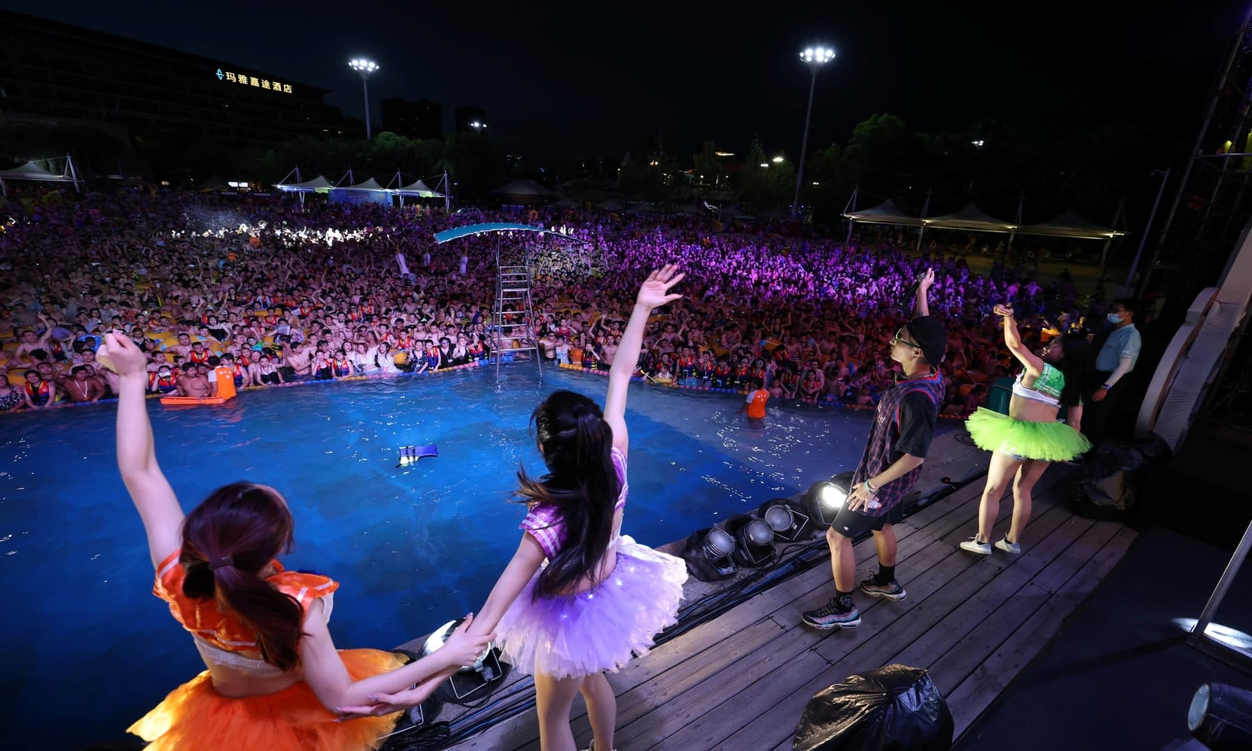 People enjoy a music party inside a swimming pool at the Wuhan Maya Beach Park on August 15, 2020. — Reuters