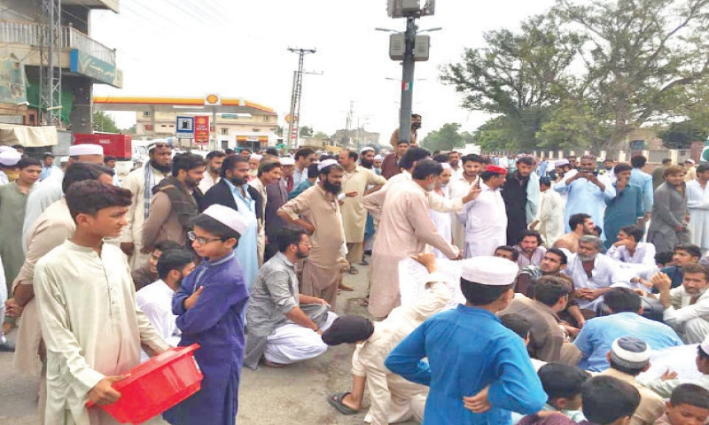 Protesters block a road in Kohat on Wednesday against power outages. — Dawn
