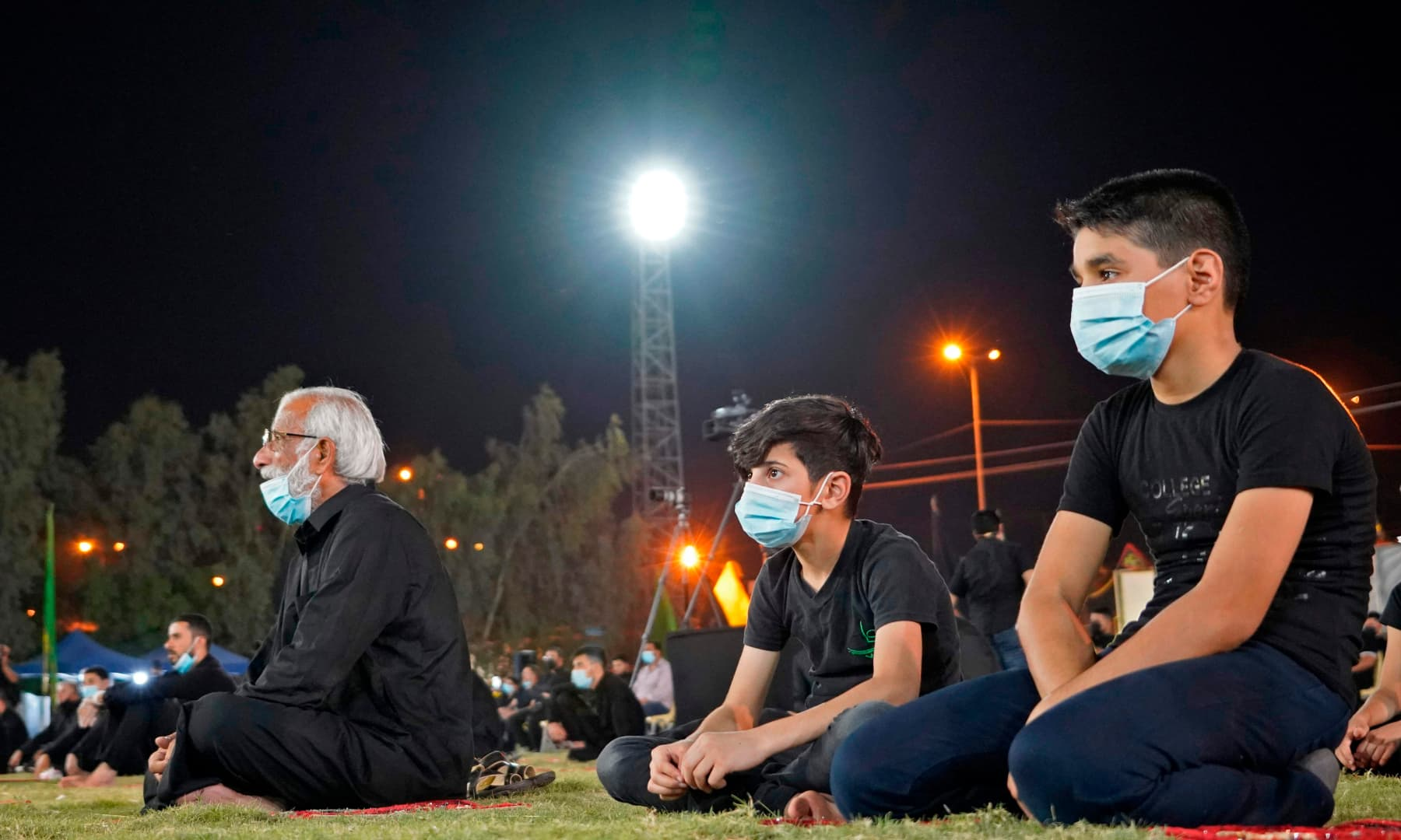 Iraqis respect social distancing due to the coronavirus pandemic as they gather to commemorate the start of the month of Muharram ahead of Ashura, in the central city of Najaf, on August 20. — AFP
