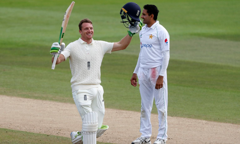 England's Jos Buttler, left, raises his bat and helmet to celebrate scoring a century during the second day of the third cricket Test match between England and Pakistan, at the Ageas Bowl in Southampton, England on Saturday. — AP