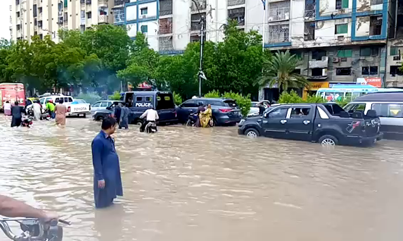 Rainwater seen on road near Natha Khan Goth. — DawnNewsTV