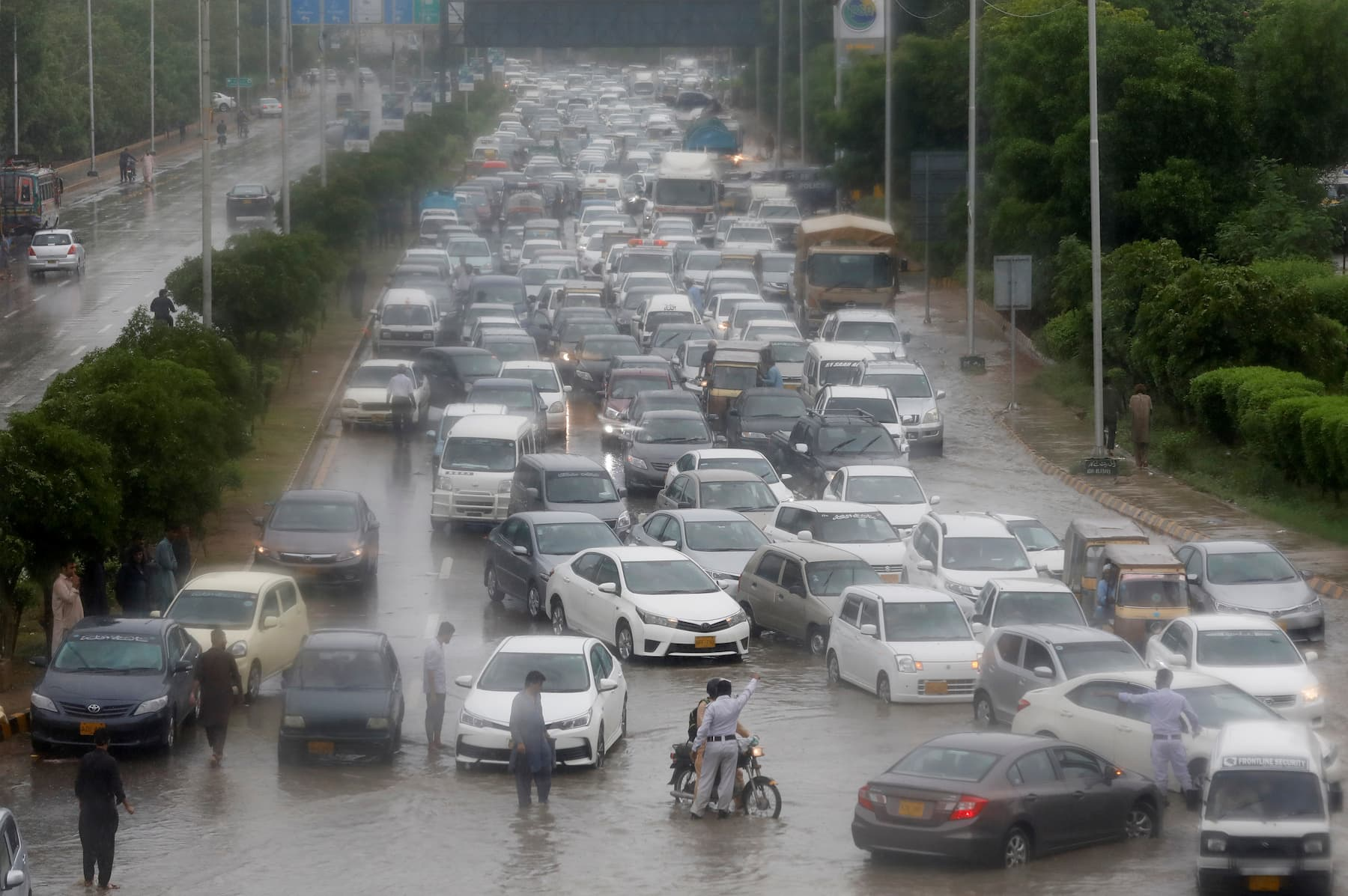 A general view shows traffic on a Karachi road during the monsoon rain on Tuesday, August 25. — Reuters