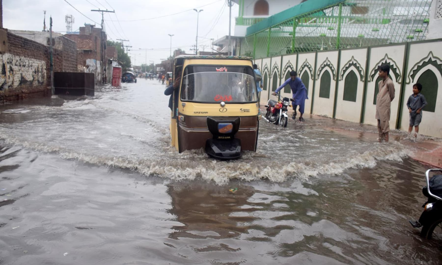 A view of a section of Makki Shah road submerged under rainwater on Tuesday afternoon in Hyderabad. — Umair Ali