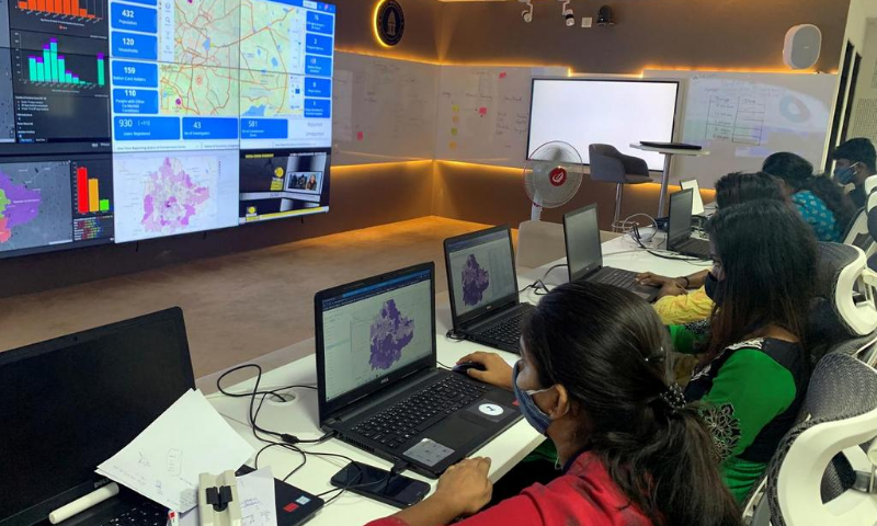 "Software professionals assisting municipal authorities work on their terminals inside a ""war room"" focused on tracking the spread of the coronavirus at the Bruhat Bengaluru Mahanagara Palike office in Bengaluru, India in July. — Reuters/File"