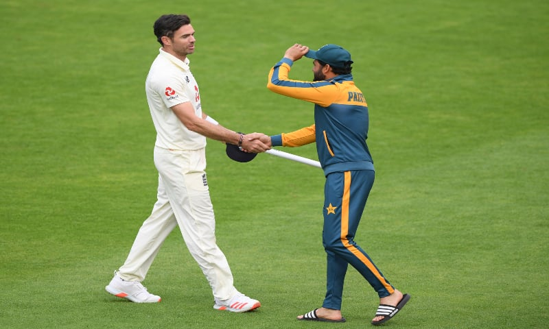 Azhar Ali, right, shakes hands with England's James Anderson at the end of the fifth day of the third cricket Test match between England and Pakistan, at the Ageas Bowl in Southampton, England, on August 25, 2020. — AP