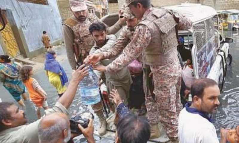 Efforts to provide succour to rain-hit families seem too short of what is demanded by the city situation. Organisations feeding the poor need better organise their work — PPI/Shakil Adil/White Star