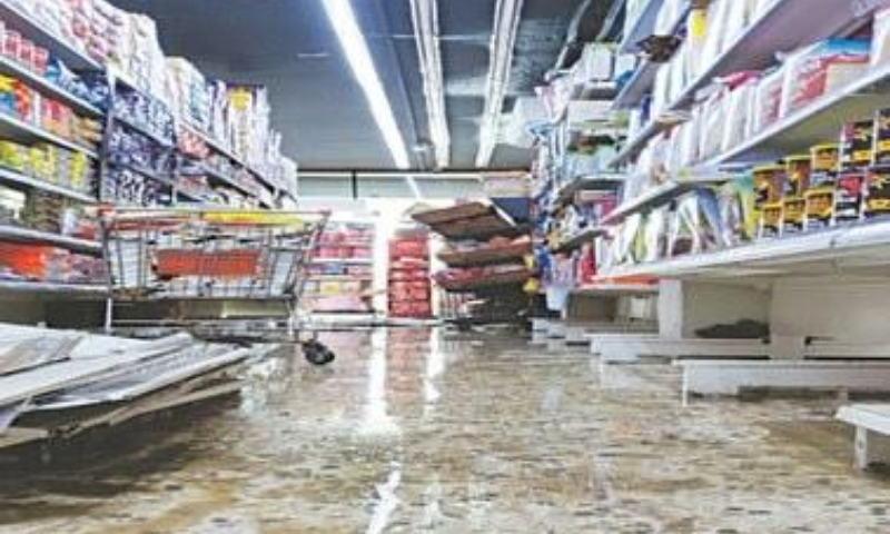 After the deluge, a flooded supermarket opens for business on Friday.