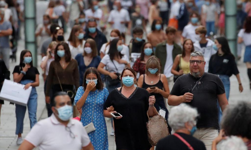 People wearing protective masks walk in a street in Nantes as France reinforces mask-wearing as part of efforts to curb a resurgence of the coronavirus  across the country. — Reuters/File
