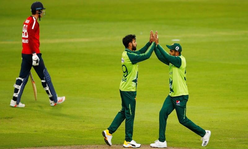 Pakistan's Imad Wasim and Shadab Khan celebrate the wicket of England's Tom Banton on Friday at Old Trafford. — Reuters