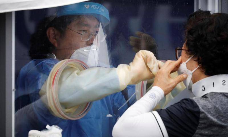 A woman undergoes a coronavirus disease test at a makeshift clinic in Seoul, South Korea. — Reuters/File