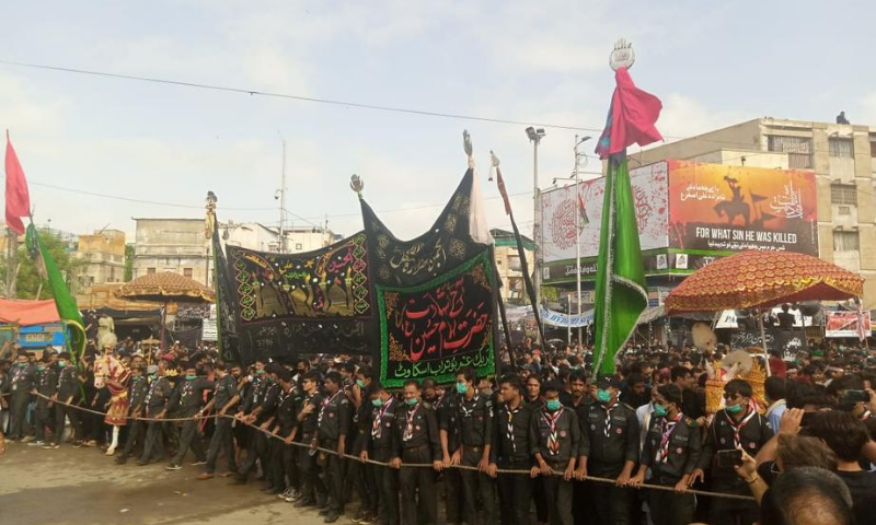 Scouts are seen in front of a Muharram procession in Karachi. — Photo courtesy Rangers