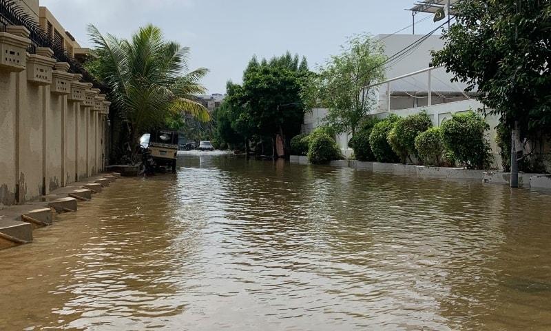 This picture shows the rainwater still accumulated at Khayaban-e-Muhafiz, DHA. — Dawn