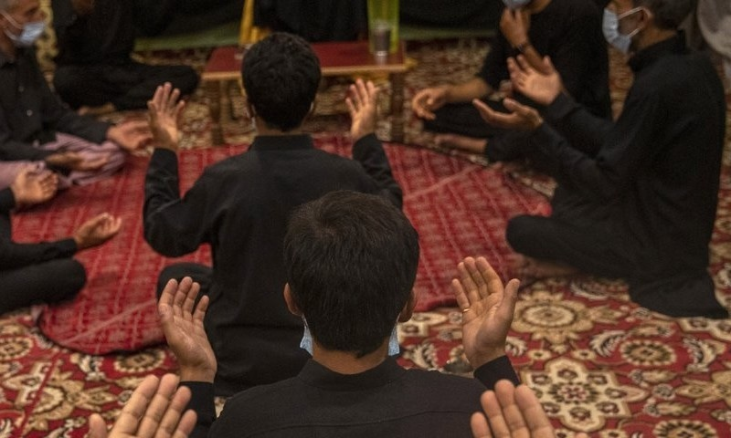 Kashmiri Shia Muslims pray as they commemorate Muharram inside their house in Srinagar on August 23. — AP