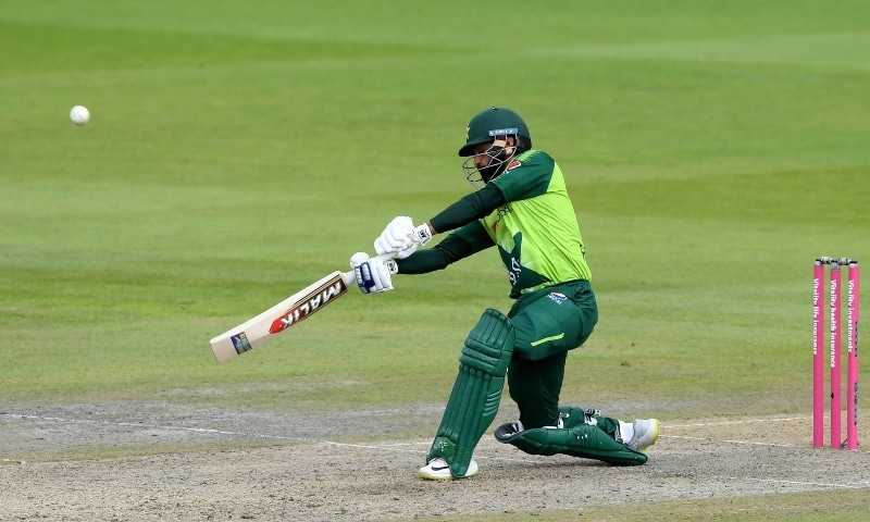Mohammad Hafeez plays a shot before he is caught by England's captain Eoin Morgan during the second Twenty20 cricket match between England and Pakistan at Old Trafford in Manchester on August 30. — AP