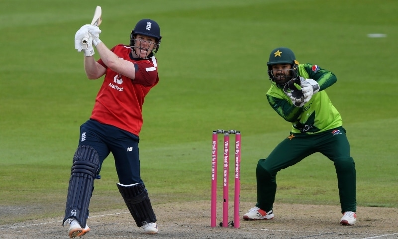 England's captain Eoin Morgan, left, reacts after hitting a boundary during the second Twenty20 cricket match between England and Pakistan  at Old Trafford in Manchester on August 30. — AP