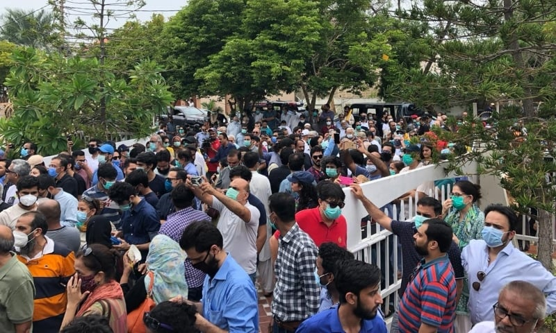Residents of DHA, Clifton protest outside the CBC office. — Dawn