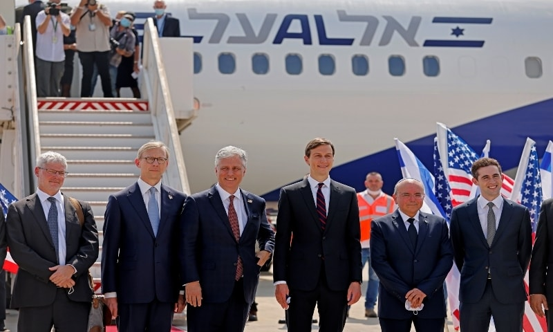 Senior US Presidential Adviser Jared Kushner and US National Security Adviser Robert O'Brien pose with members of the Israeli-American delegation in front of the El Al's flight LY971, which will carry the delegation from Tel Aviv to Abu Dhabi at Ben Gurion Airport, near Tel Aviv, Israel on August 31, 2020. — Reuters