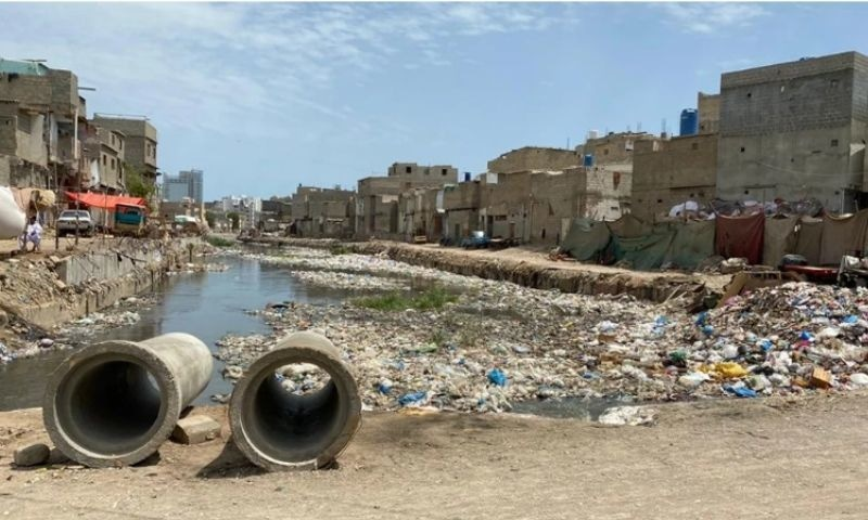 Encroachments along Karachi's Mehmoodabad drain; cleaning work remained incomplete at the start of the monsoon. — Photo courtesy: Karachi Municipal Corporation