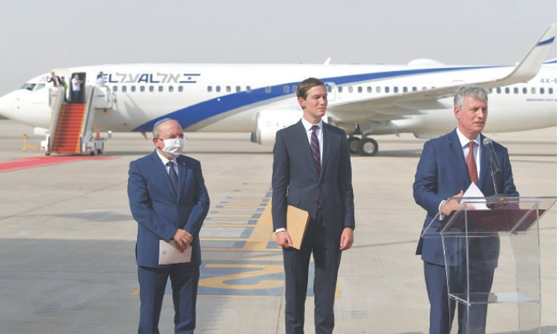 ABU DHABI: US National Security Adviser Robert O'Brien speaks next to US Presidential Adviser Jared Kushner (centre) and Head of Israel's National Security Council Meir Ben-Shabbat in front of an aeroplane of El Al at the tarmac of Abu Dhabi airport on Monday. — AFP