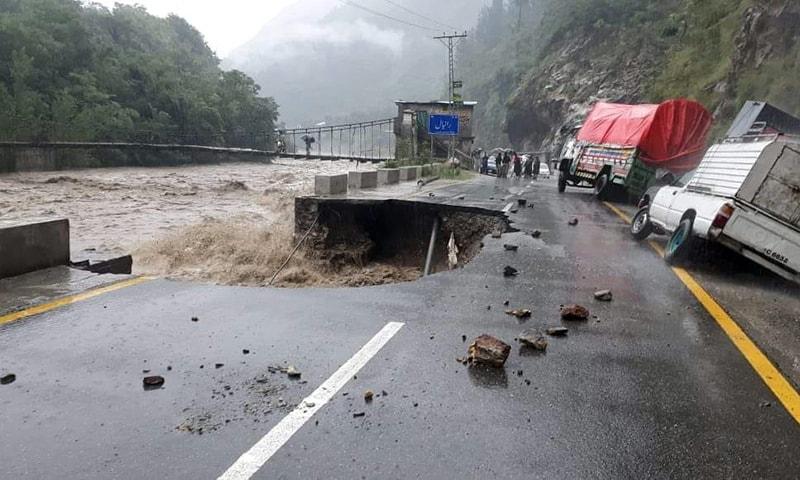 A road caved in due to flooding in Khan Khwar near Ranyal in Shangla. — Photo: Umar Bacha