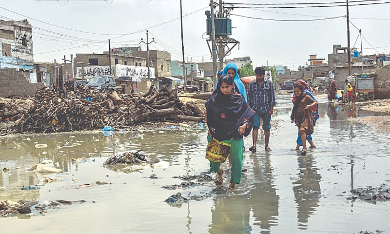 Scenes of devastation and misery abound in Surjani Town on Tuesday.—Fahim Siddiqi/White Star