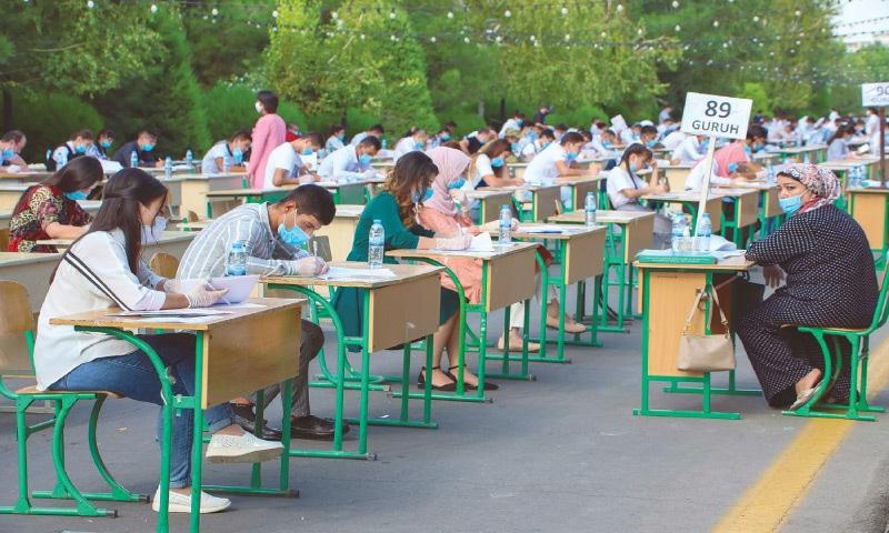 TASHKENT (Uzbekistan): Students take open-air entrance exams on Wednesday amid the ongoing pandemic.—AFP