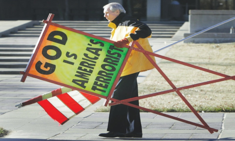 In this photo taken July 2007, Fred Phelps Sr., pastor of the Westboro Baptist Church in Topeka, Kansas, prepares to protest outside the Kansas Statehouse | AP
