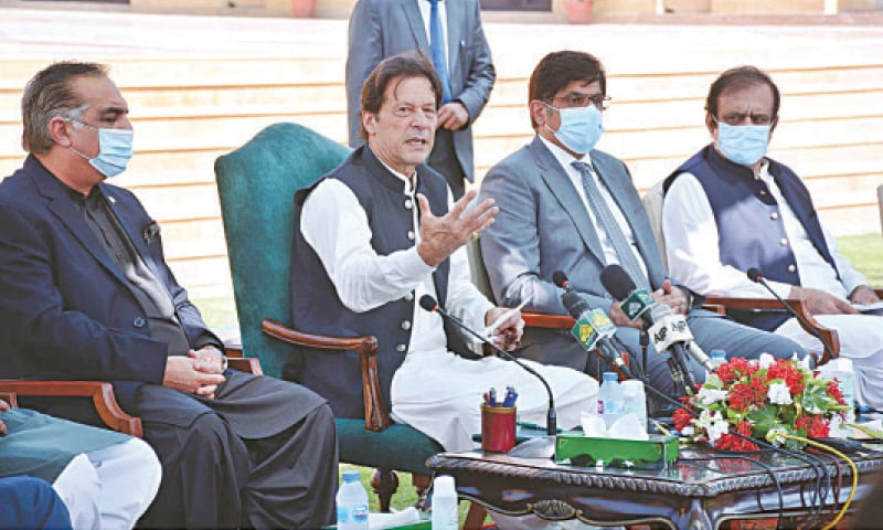 KARACHI: Prime Minister Imran Khan flanked by Sindh Governor Imran Ismail and Chief Minister Syed Murad Ali Shah announces the Karachi Transformation Plan on Saturday. Federal Information Minister Shibli Faraz is also seen at the event held at Governor House. — APP