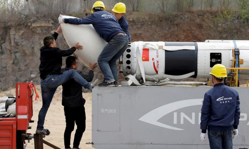Engineers install the payload fairing before a test launch of LinkSpace's reusable rocket RLV-T5, also known as NewLine Baby, in Longkou, Shandong province, China, April 18, 2019. — Reuters/File