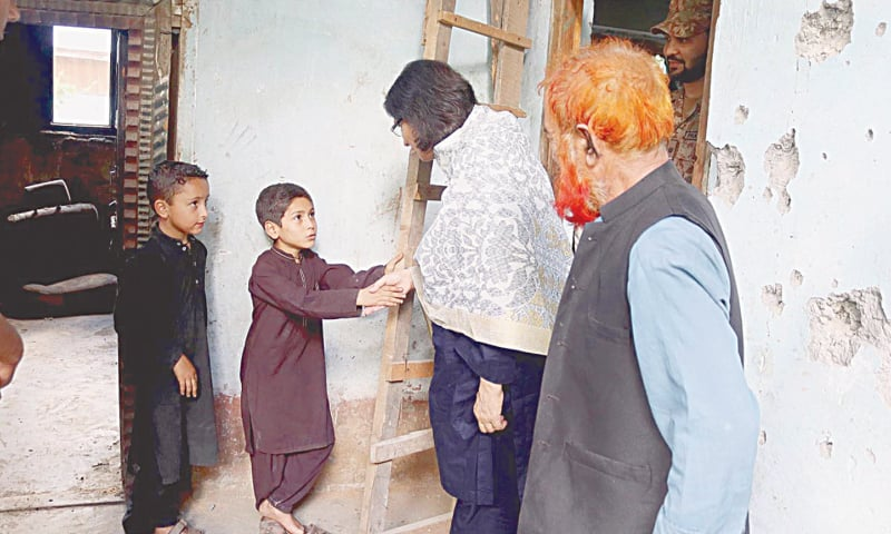MUZAFFARABAD: Special Assistant to the Prime Minister on Social Protection and Poverty Alleviation Dr Sania Nishtar shakes hands on Sunday with a young member of a family at a village in Neelum Valley, whose house has been damaged in unprovoked shelling by Indian forces from across the Line of Control. — APP