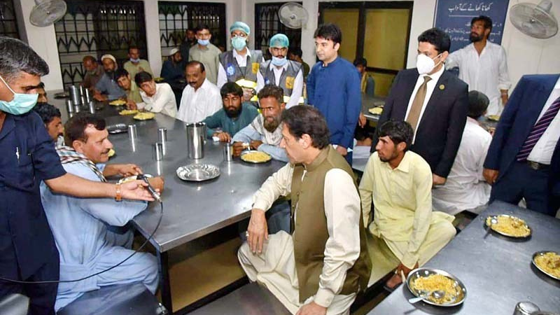 Prime Minister Imran Khan interacting with the temporary residents during visit to Model Panahgah Tarlai. — APP