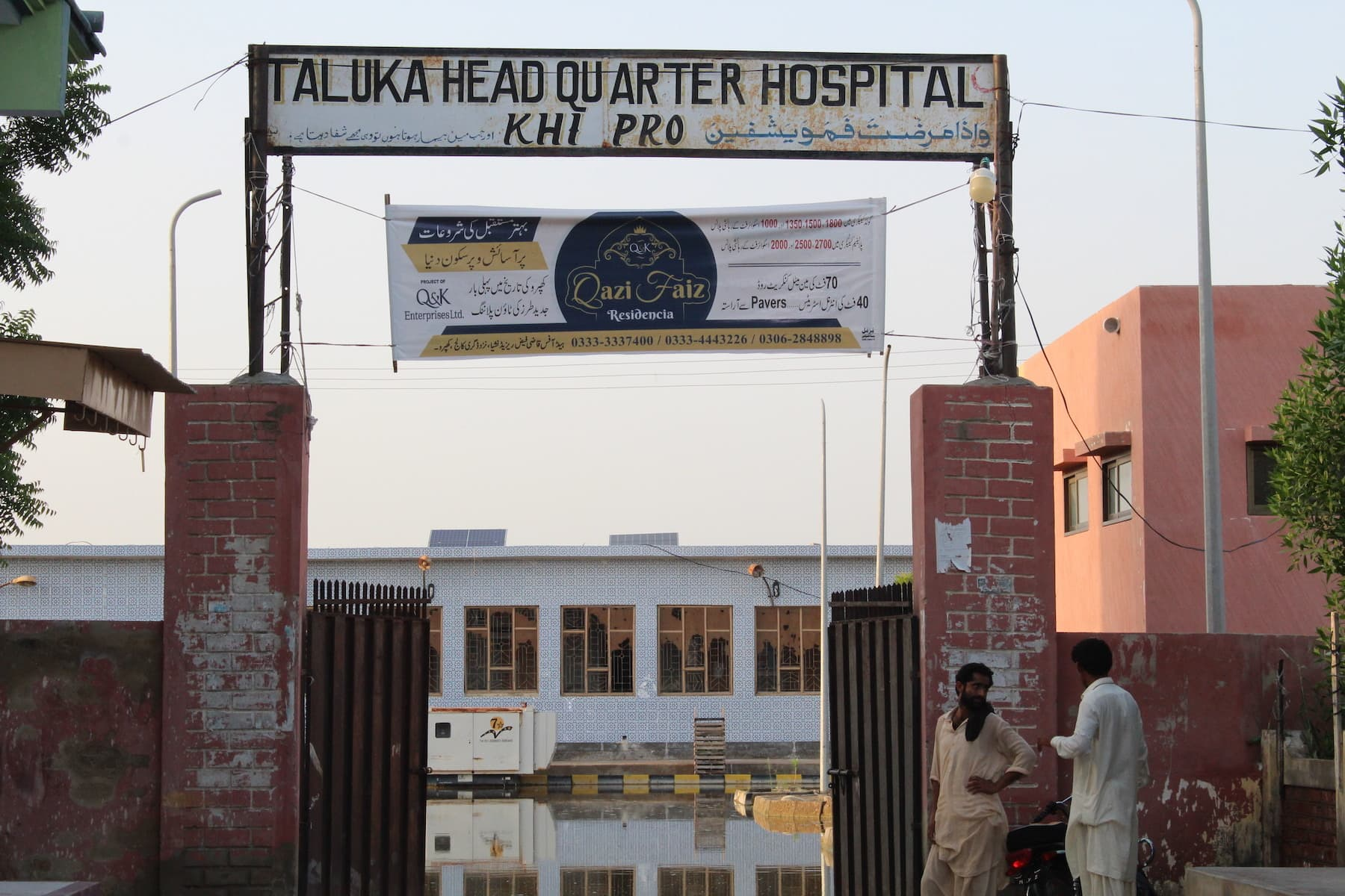 The Taluka Headquarter Hospital Khipro is flooded in ankle-deep water for the past 15 days. Attendants must carry the patients into the main building. — Photo by author