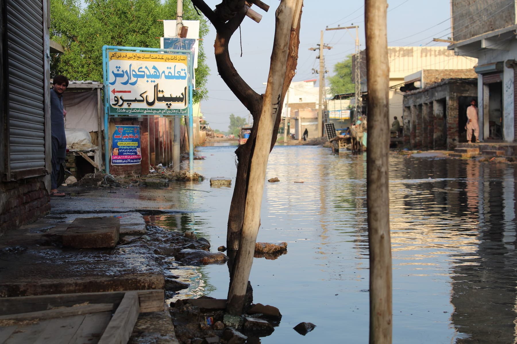 The road leading to the Taluka Headquarter Hospital Khipro is flooded in waist-deep water, mixed with sewerage for the past 15 days. — Photo by author