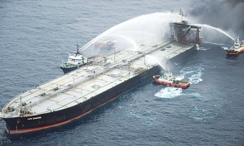 COLOMBO: Fireboats battle to extinguish a fire on the oil tanker on Tuesday.—AFP