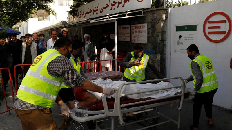 Afghan men carry an injured person to a hospital after a blast in Kabul, Afghanistan on Wednesday. — Reuters