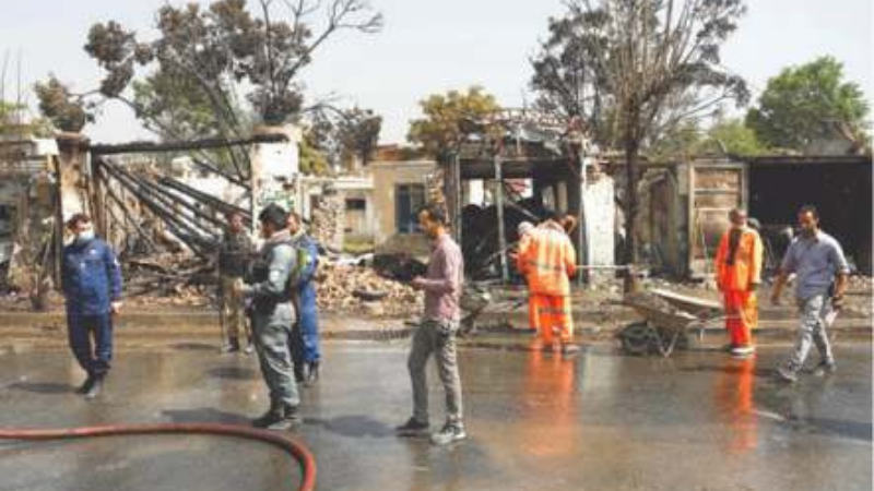 Security personnel and municipal workers pictured at the site of the blast on Wednesday. —Reuters